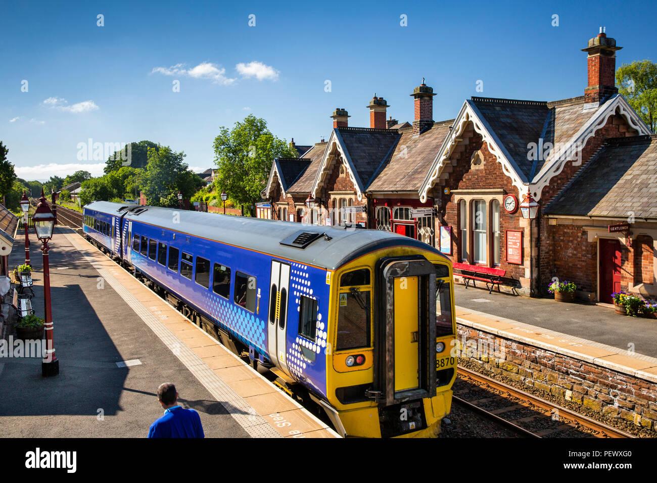 UK, Cumbria, Eden Valley, Appleby Station on Settle to Carlisle Line, Northern Rail train at southbound platform - Stock Image