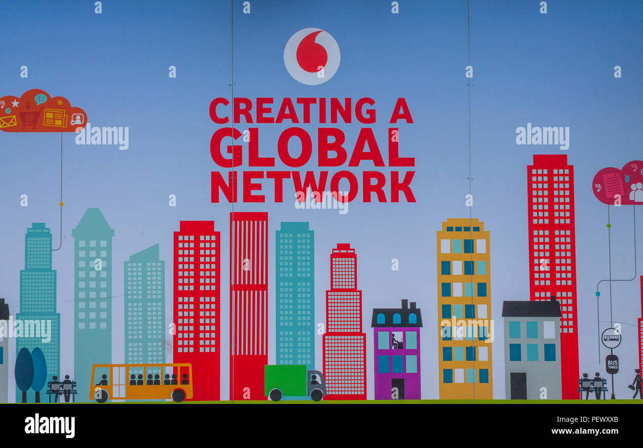 Vodafone logo advertising a global network on an advertising hoarding, or advertising board. Stock Photo