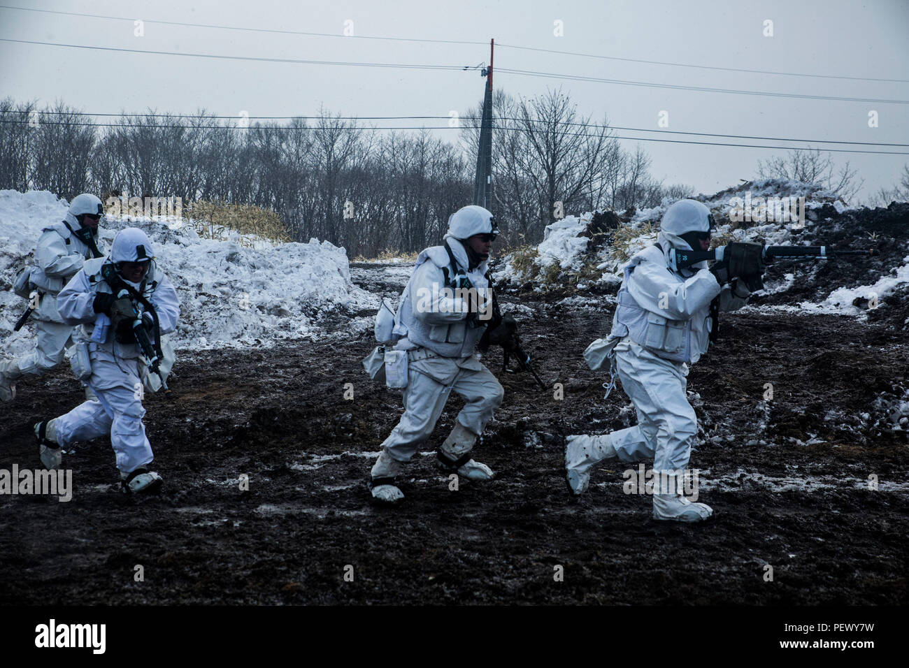 Japan Ground Self-Defense Force soldiers conduct urban operations while quickly approaching an enemy urban area during Forest Light 16-2 in Yausubetsu Training Area, Hokkaido, Japan, Jan. 28, 2016. The exercise strengthens military partnership, solidifies regional security agreements and improves individual and unit-level skills. The JGSDF soldiers are with the 27th Infantry Regiment, 5th Brigade, Northern Army. The Marines are with Kilo Company, 3rd Battalion, 5th Marine Regiment currently assigned to 4th Marine Regiment, 3rd Marine Division, III Marine Expeditionary Force. (U.S. Marine Corps Stock Photo
