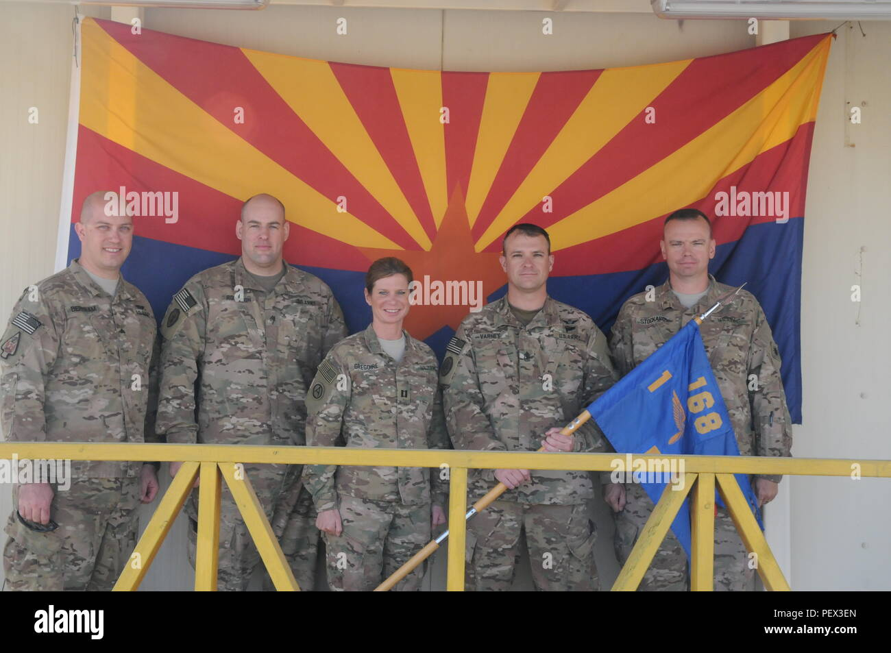 Nashville, Tenn., resident Sgt. Brian Bertram, Glendale, Ariz., resident Sgt. Nicholas Robinson, San Tan Valley, Ariz., resident Cpt. Sherri Gregoire, Tucson, Ariz., resident 1st Sgt. Trevor Varney, and Phoenix resident Sgt. 1st Class Kevin Stockard gather outside their company headquarters for Company F, 1st Battalion, 168th Air Traffic Services, 40th Combat Aviation Brigade, at Camp Buehring Kuwait, Feb. 8. Capt. Gregoire and 1st Sgt. Varney are the command team for Company F, which provides Air Traffic Services for all friendly aviation assets. (Photo by 1st Lt. Aaron DeCapua, 40th Combat A - Stock Image