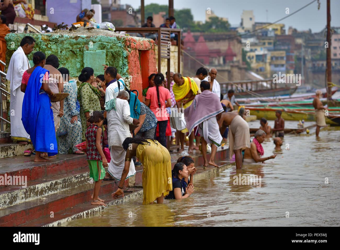 Hindu Indian pilgrims bathing and praying in Ganges river Stock Photo