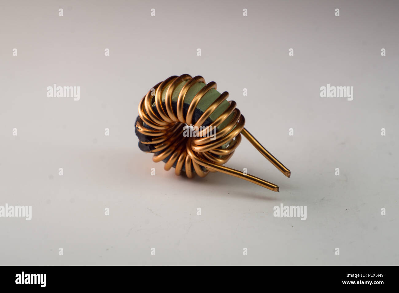 Inductor Stock Photos Images Alamy Simple Circuit A Small Copper Wire Wrapped Ferrite Core Choke With White Background