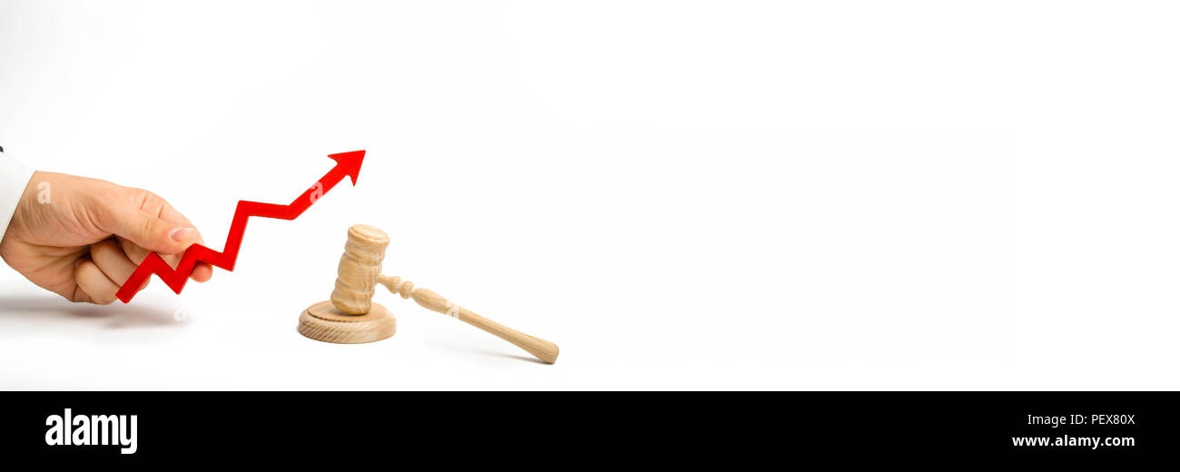 hand holds the arrow up near the judge's hammer. concept of increasing the percentage of disclosure of criminal cases, the last percent of accusatory  - Stock Image