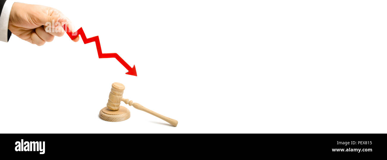 The hand holds the arrow down near the judge's hammer. reduces the percentage of disclosure of criminal cases, lowering the percentage of accusatory o - Stock Image