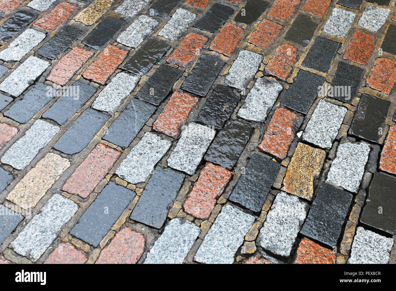 Granite stone pavement bricks in London Stock Photo