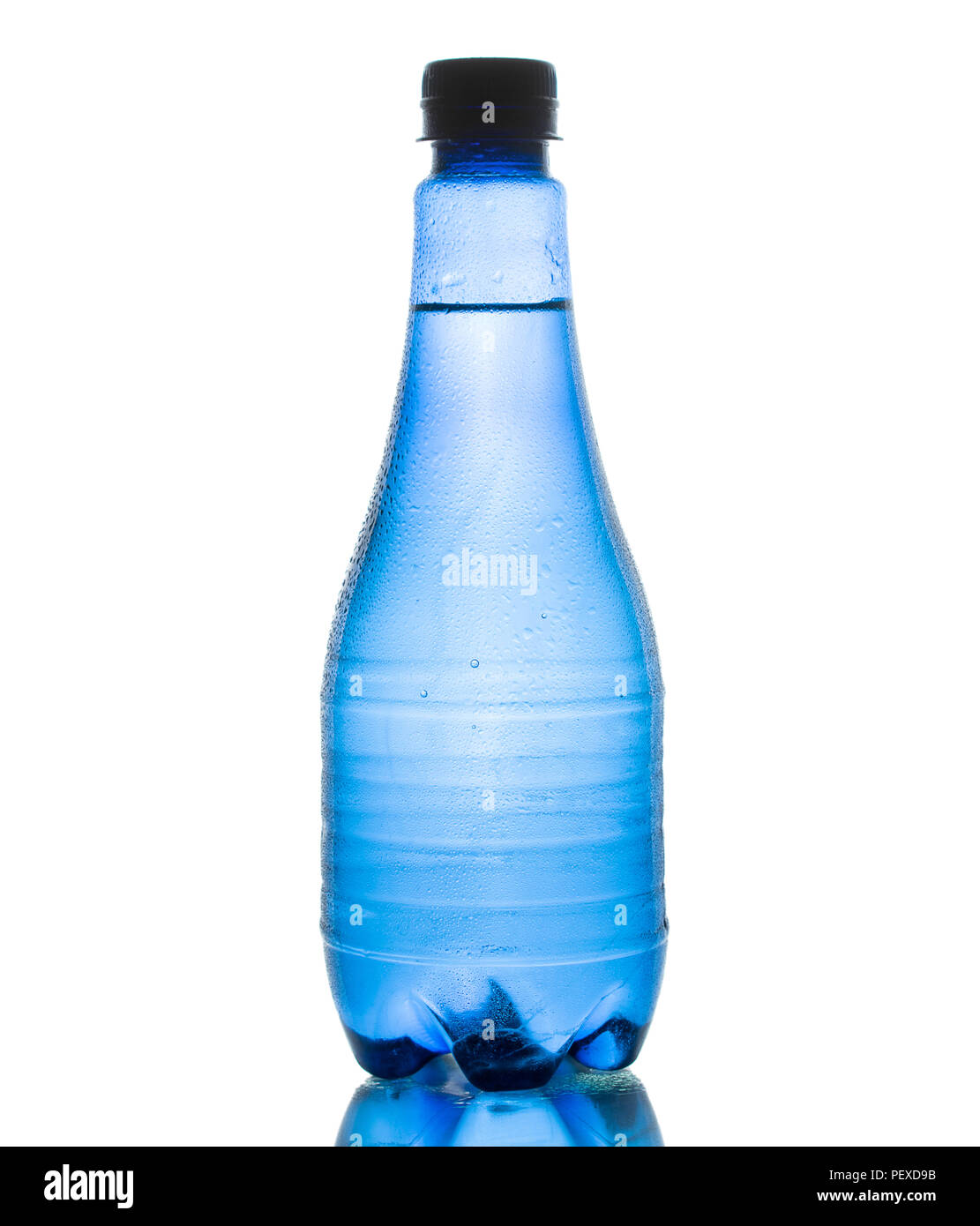Blue water bottle isolated on white background with small water droplets - Stock Image