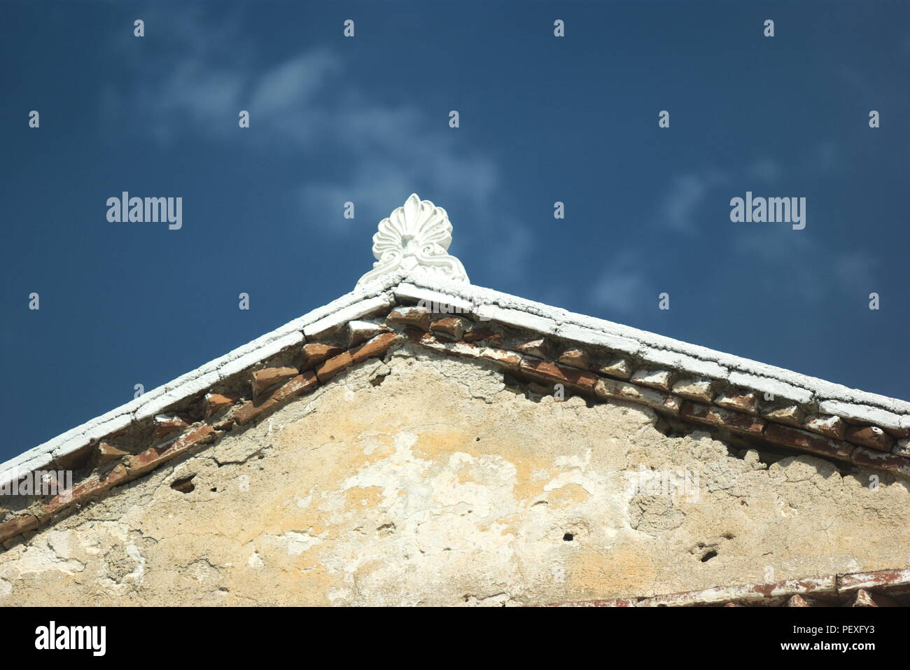 Greece, the island of Ios.  An old building at the harbor.  The stucco contrasting to the deep blue sky - Stock Image