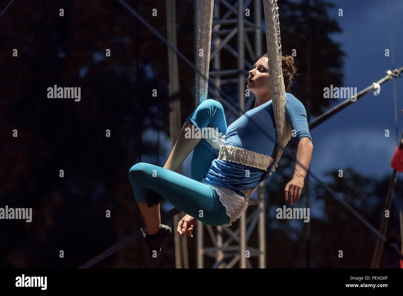 Letna, Prague - July 15: Performer, the artist floats over the stage, tied with fabricduring XV. International Festival of New Circus and Theatre on J - Stock Image
