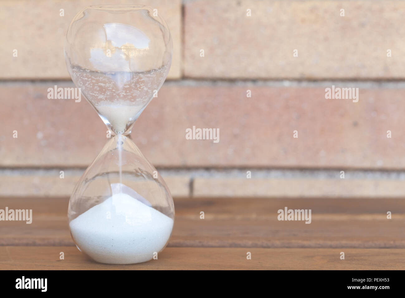 Hourglass - time passing by concept Stock Photo