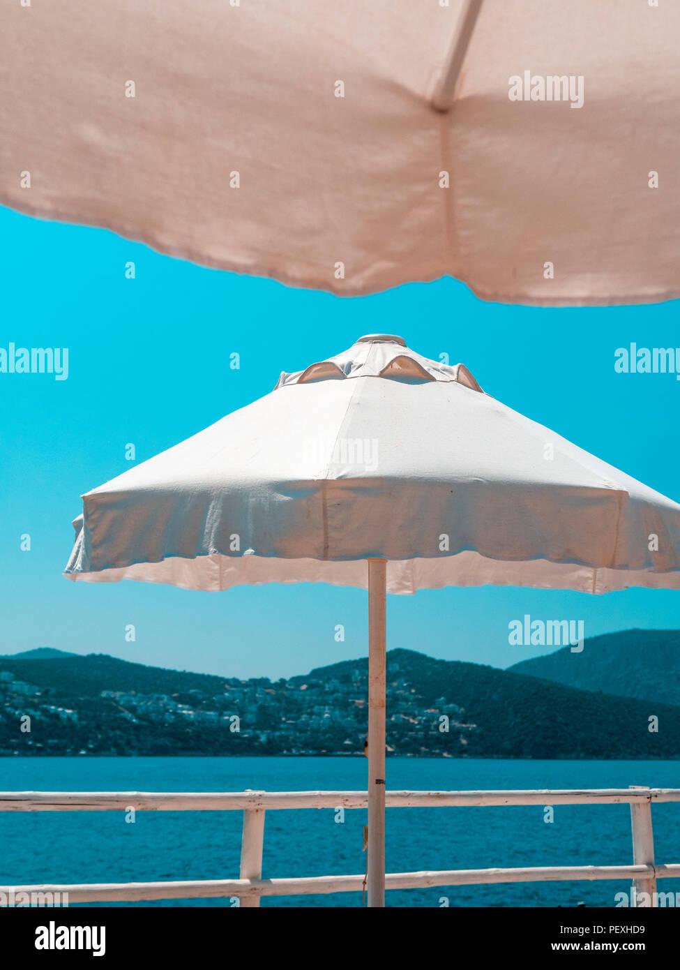 Beach Umbrellas against Blue Sky - Stock Image