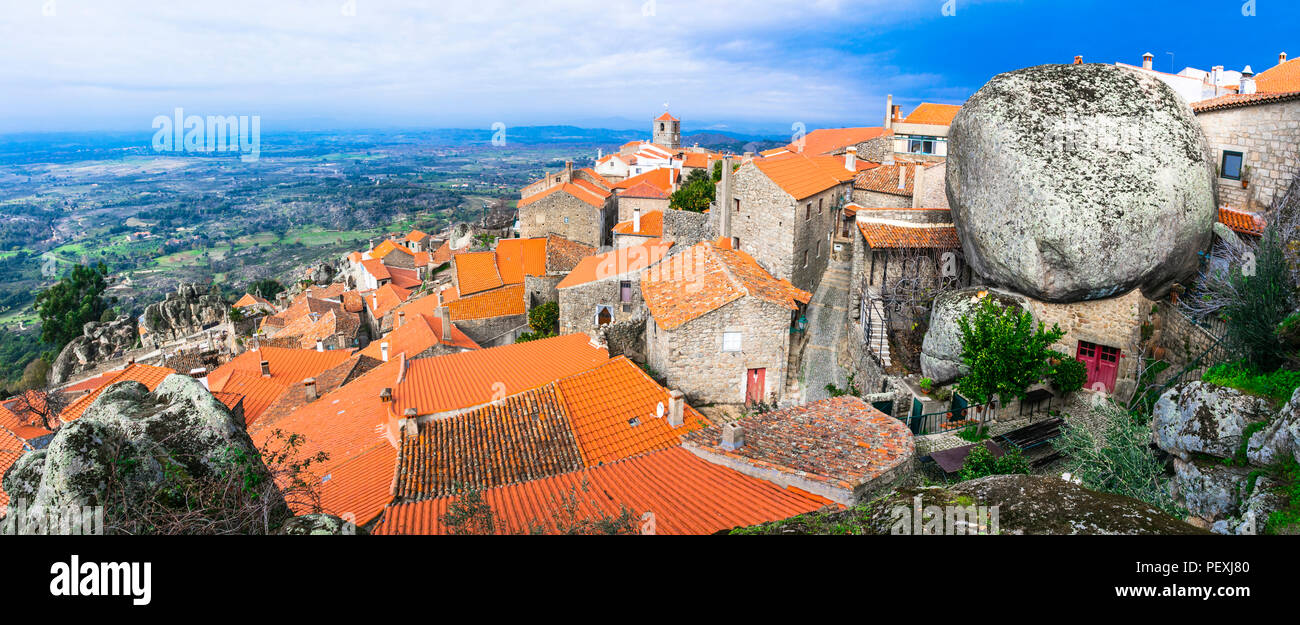 Incredible Monsanto village,view with traditional houses over cliffs,Portugal. - Stock Image