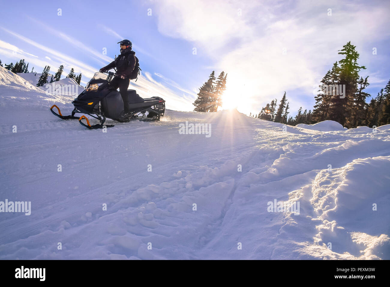Man riding snowmobile in Callaghan Valley, Whistler, British Columbia, Canada - Stock Image