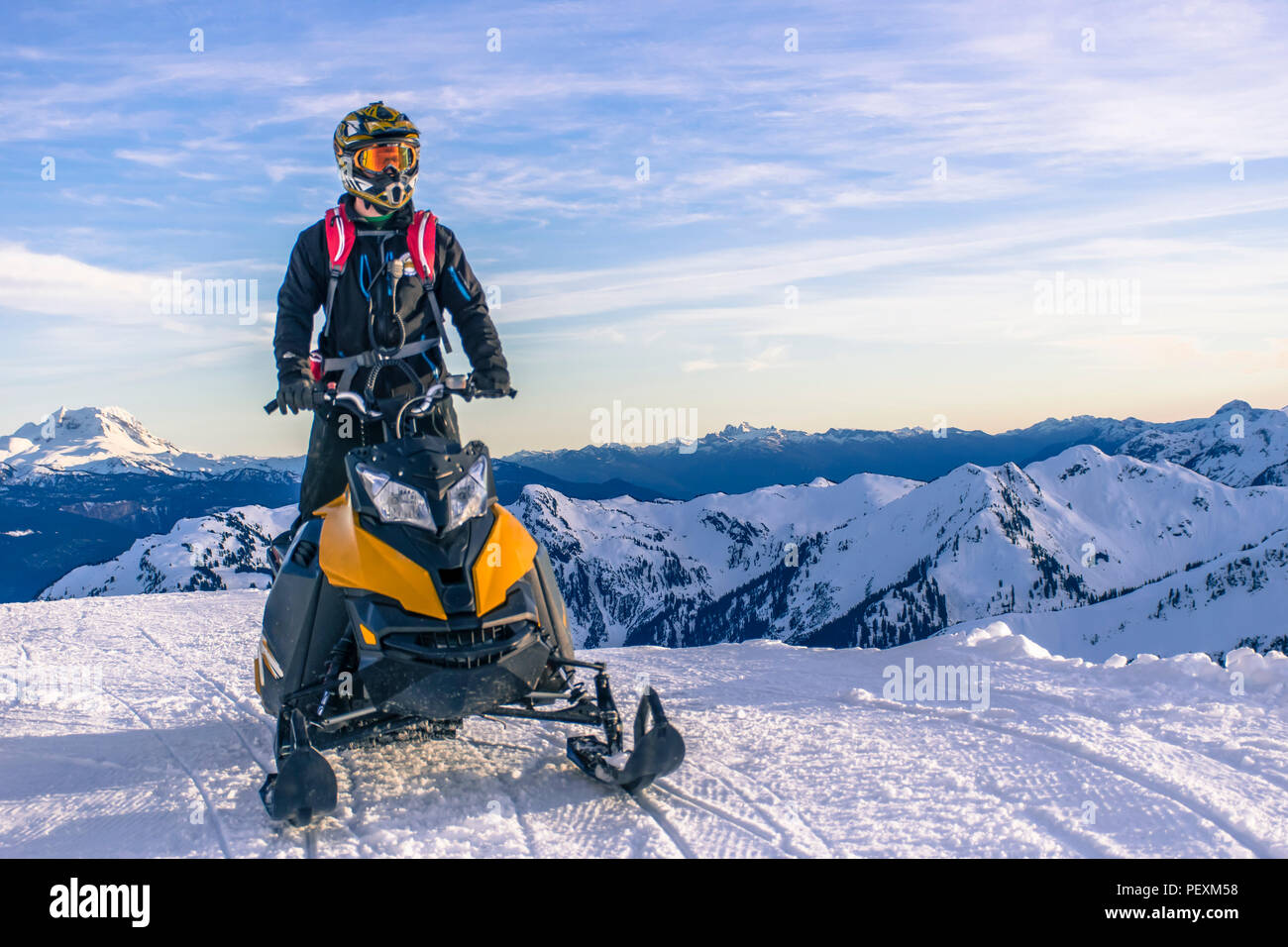 Man on snowmobile, Whistler, British Columbia, Canada - Stock Image