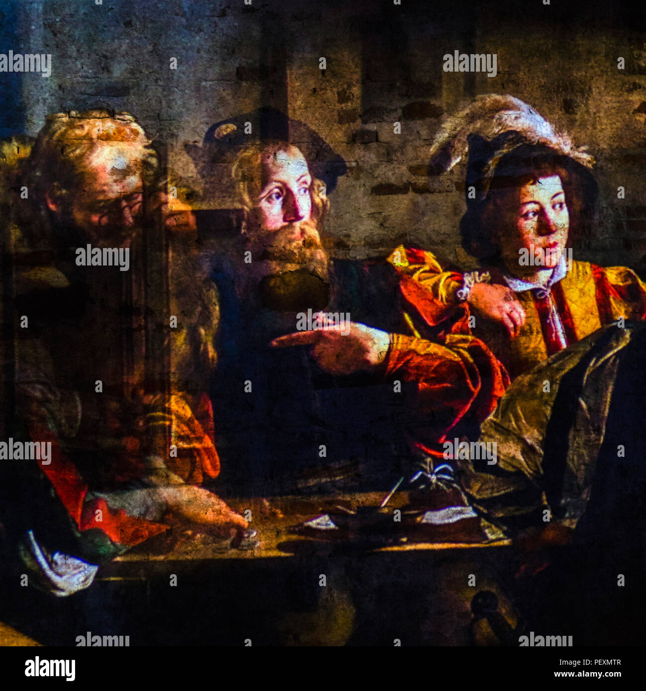 The Calling of Saint Matthew by Caravaggio projected on wall, Lucca, Tuscany, Italy - Stock Image