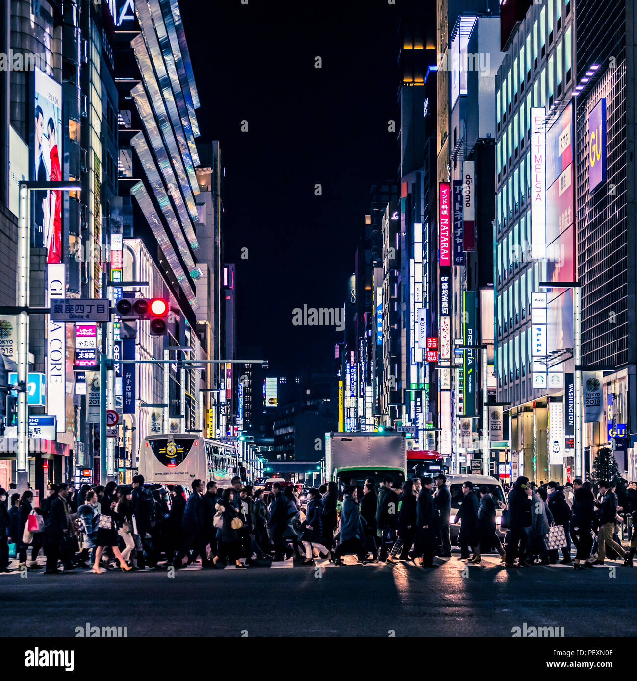 Crowd of people on street in Ginza district, Tokyo, Japan - Stock Image