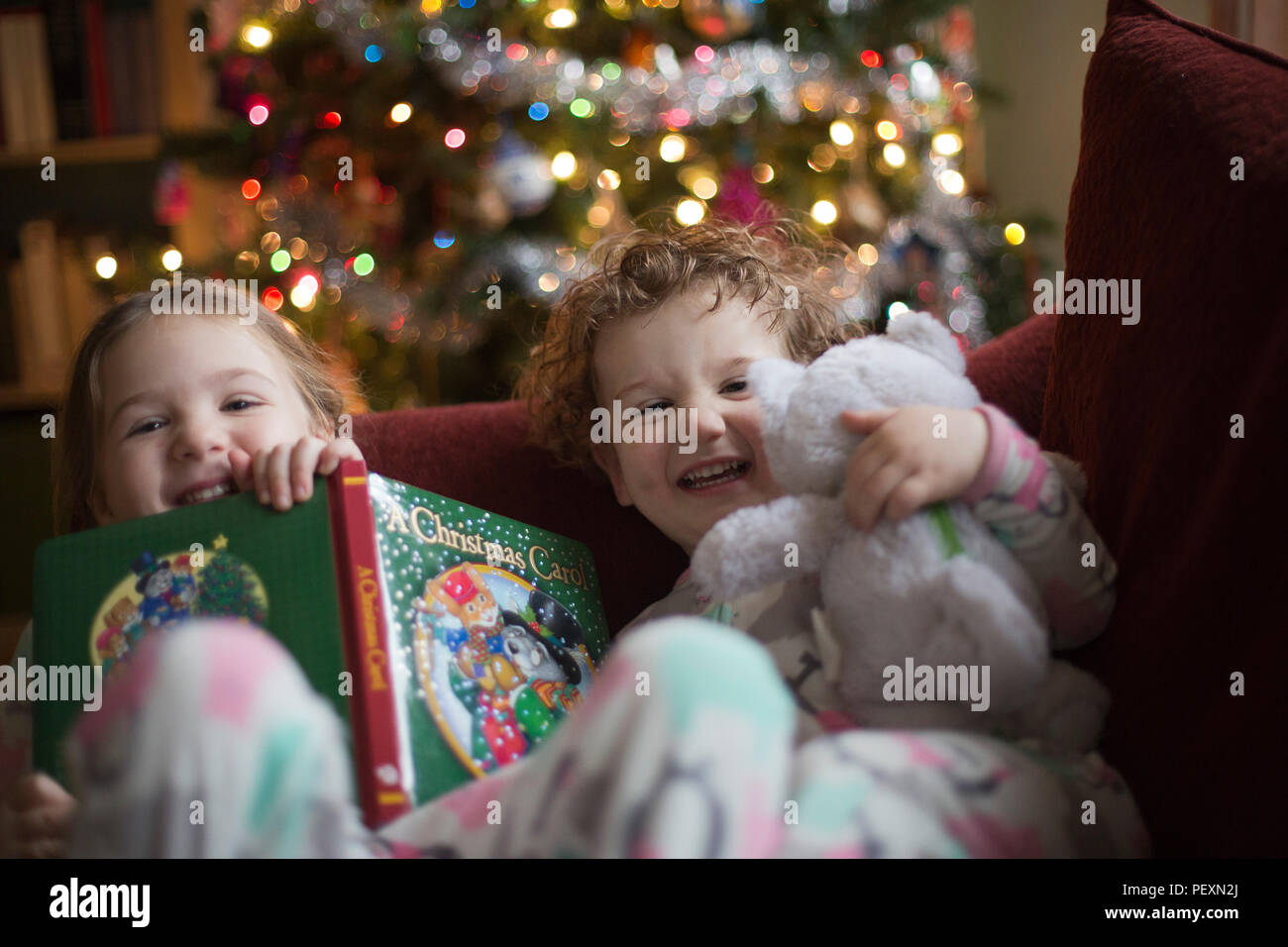 Brother and sister during Christmas - Stock Image