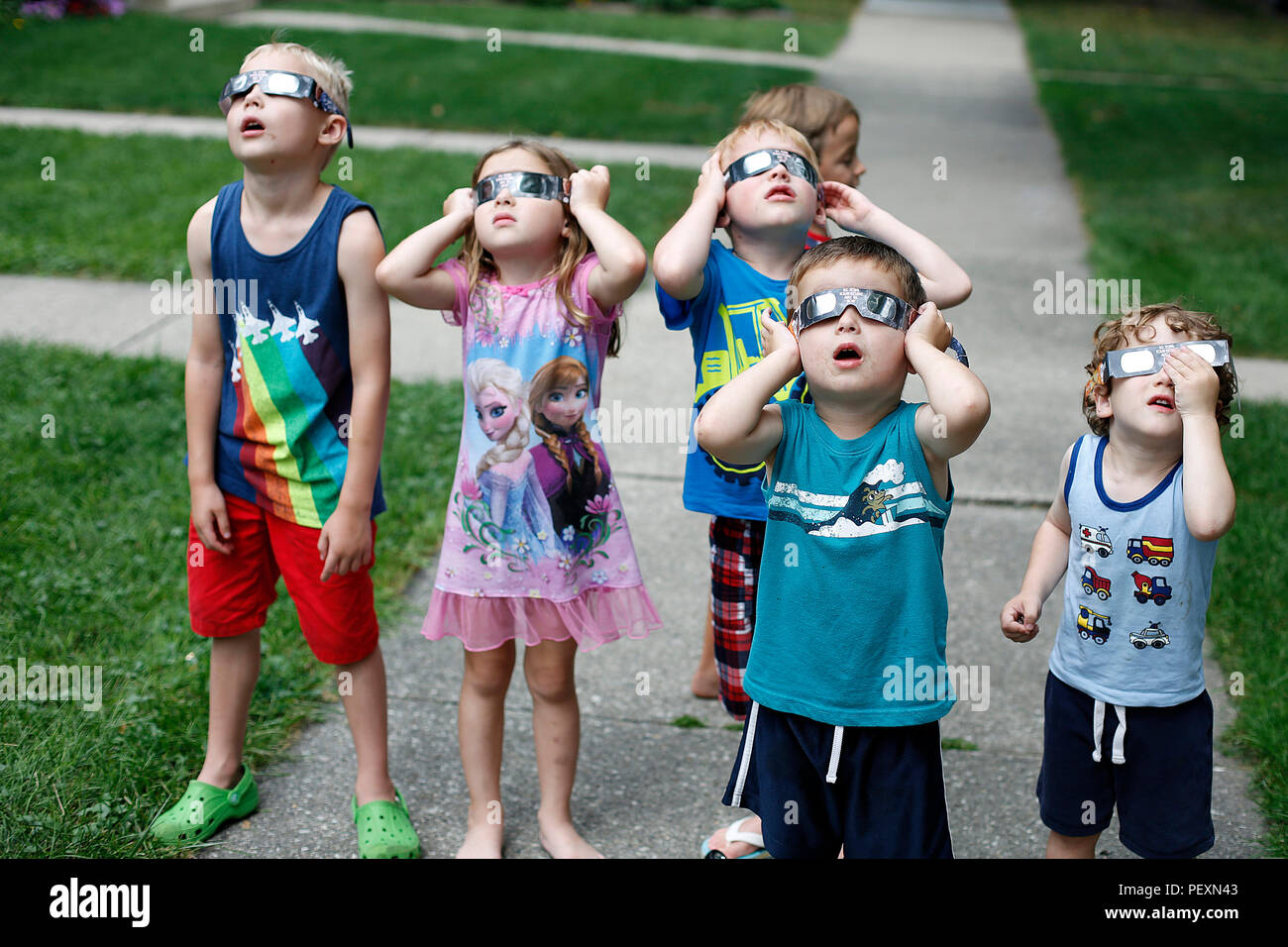 Group of children watching solar eclipse Stock Photo