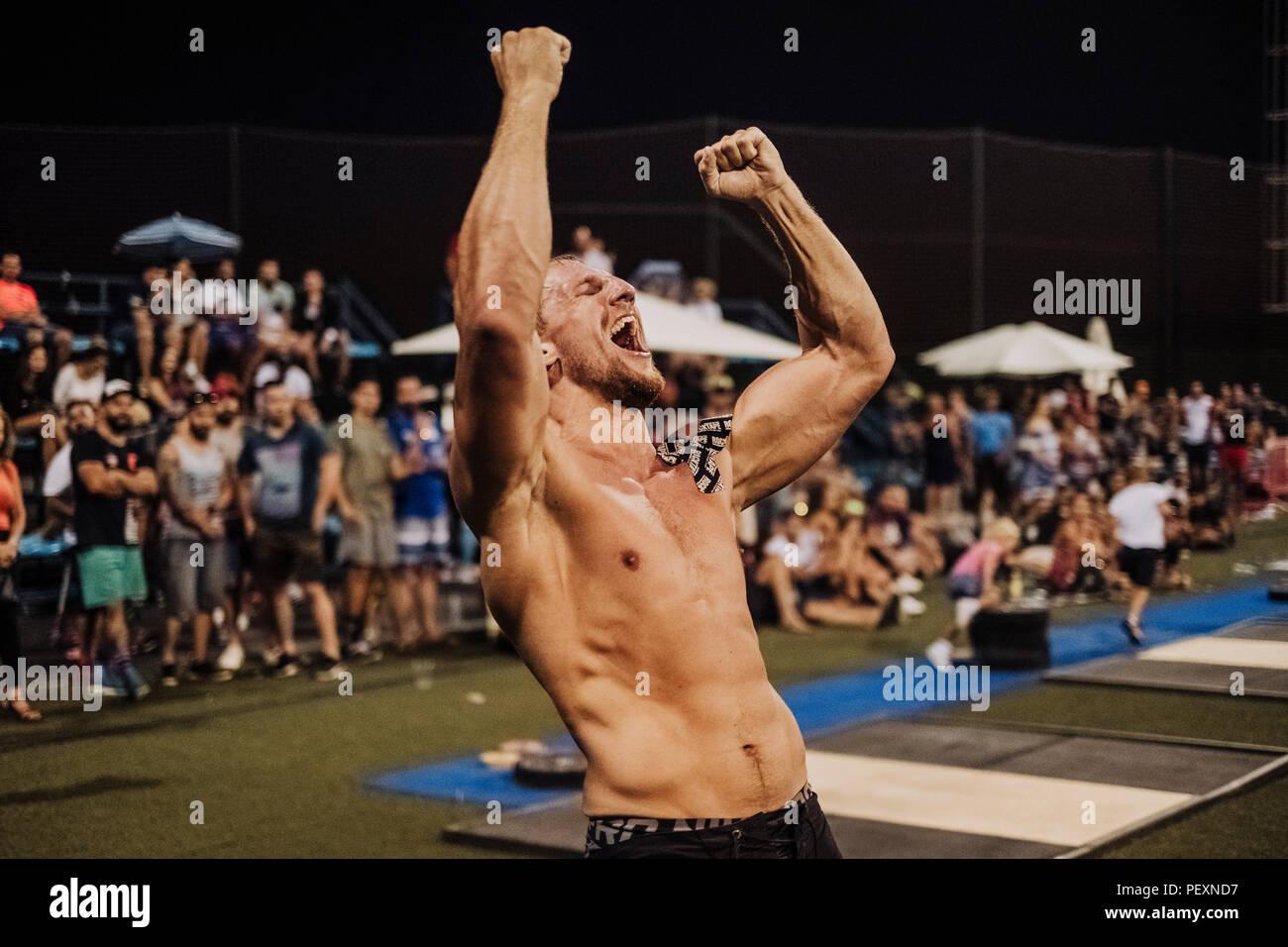 Crossfit athlete celebrating victory - Stock Image