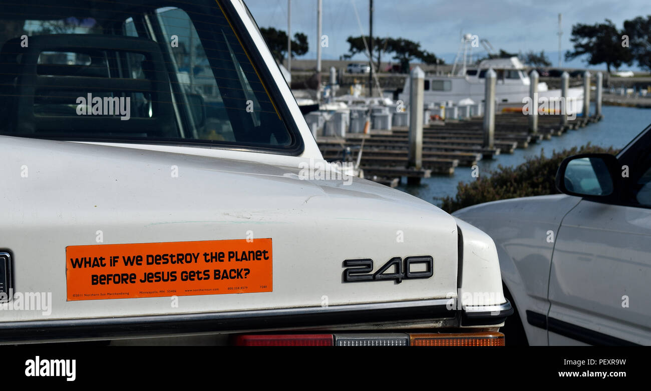 What if we destroy the planet before Jesus gets back, a message sticker on the back of a car in , California - Stock Image