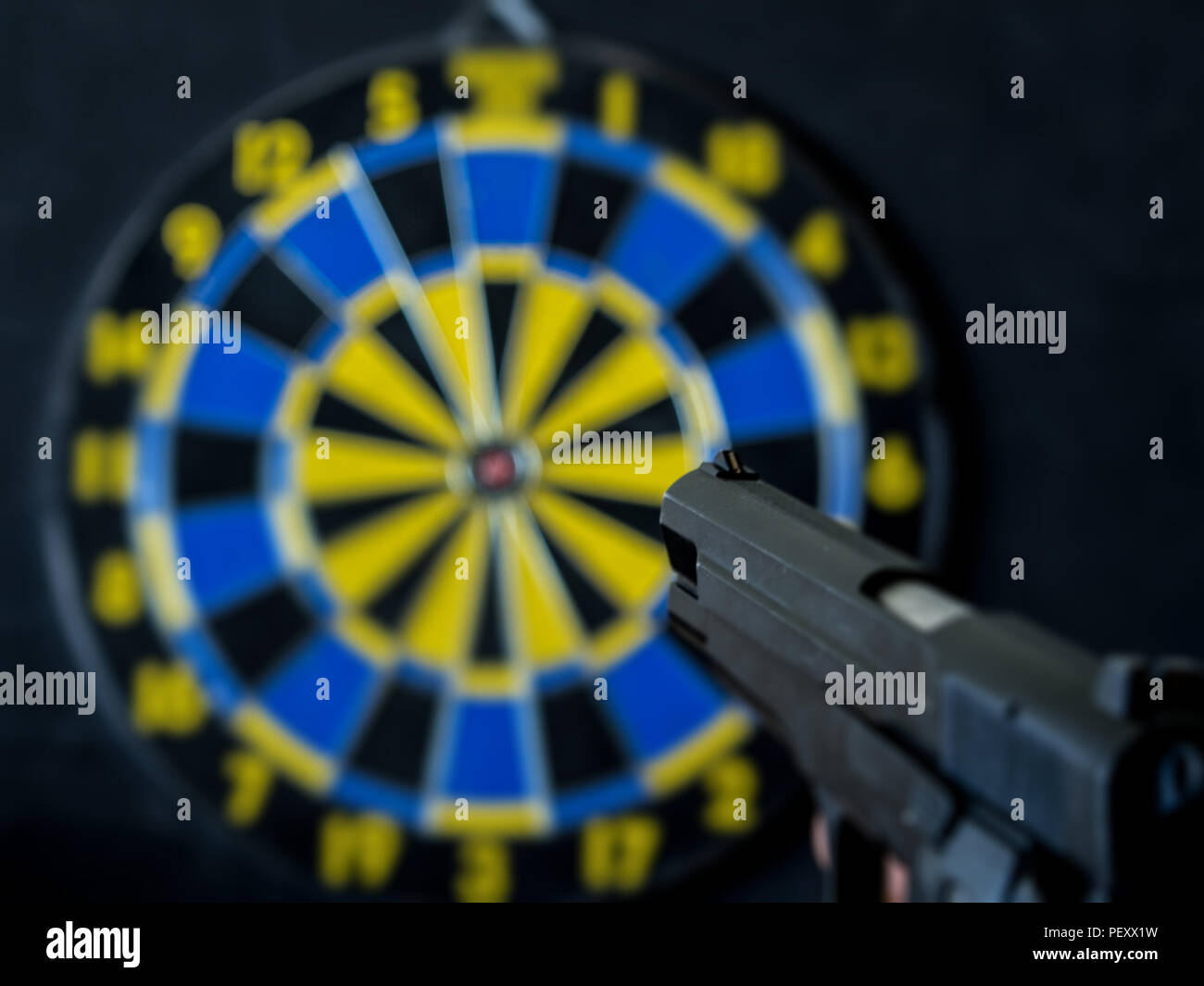 aim at the target with the pistol - Stock Image