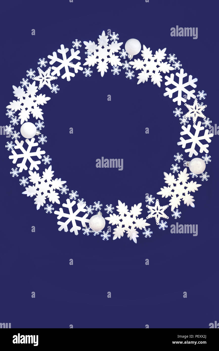 Snowflake Christmas Wreath On Blue Background With Copy Space