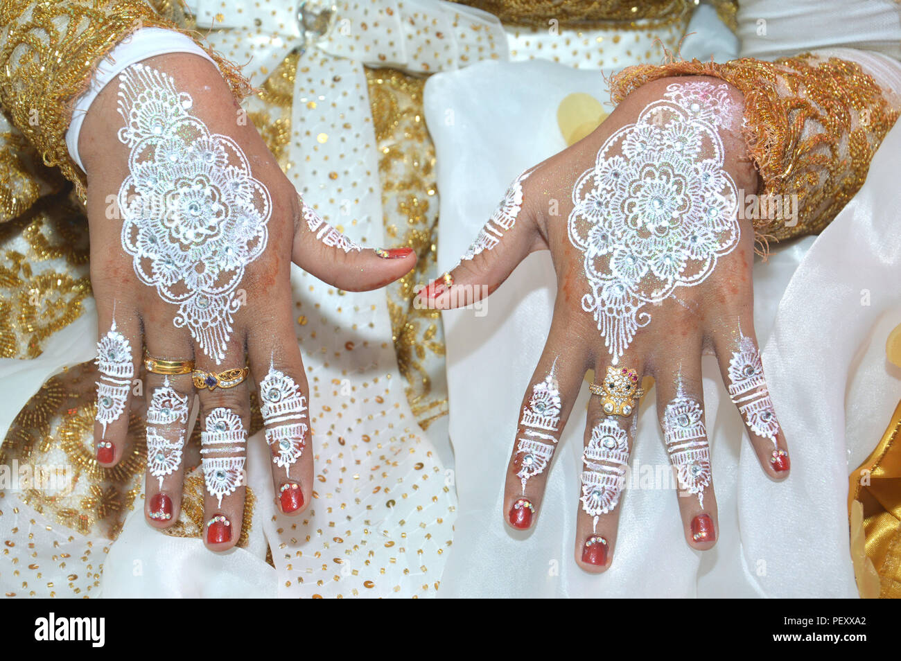 White Henna On Hands Of Indonesian Wedding Bride Stock Photo