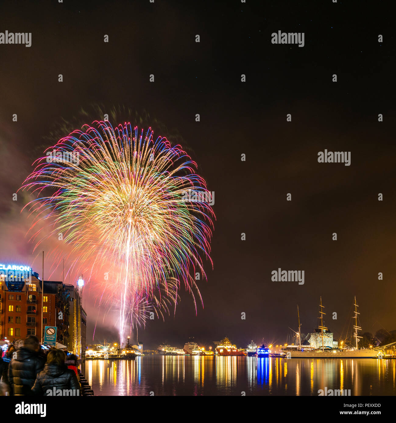 Fireworks in Bergen, Norway, at New years eve celebration. - Stock Image