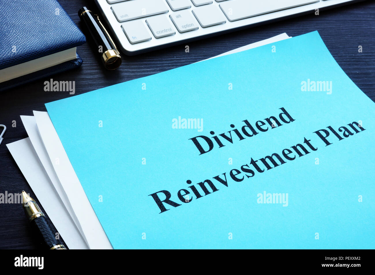 Dividend Reinvestment Plan - DRIP on the desk. - Stock Image