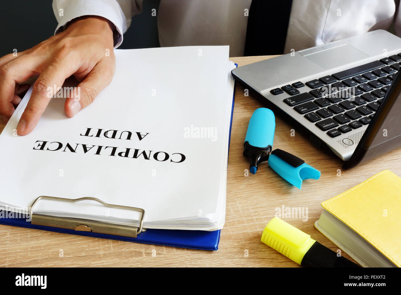 Auditor is holding compliance audit report. - Stock Image