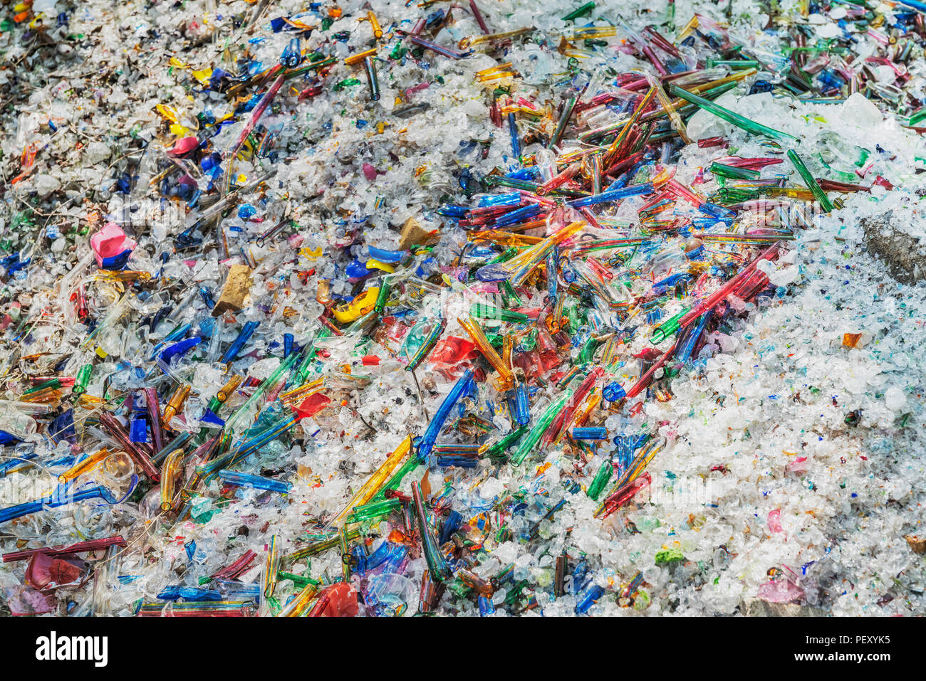 Many small colorful bits of broken glass on a pile - Stock Image