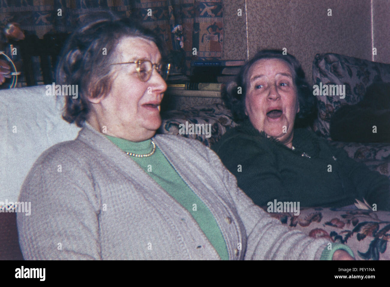 Two old women laughing with each other. Image taken 1960s/70s - Stock Image