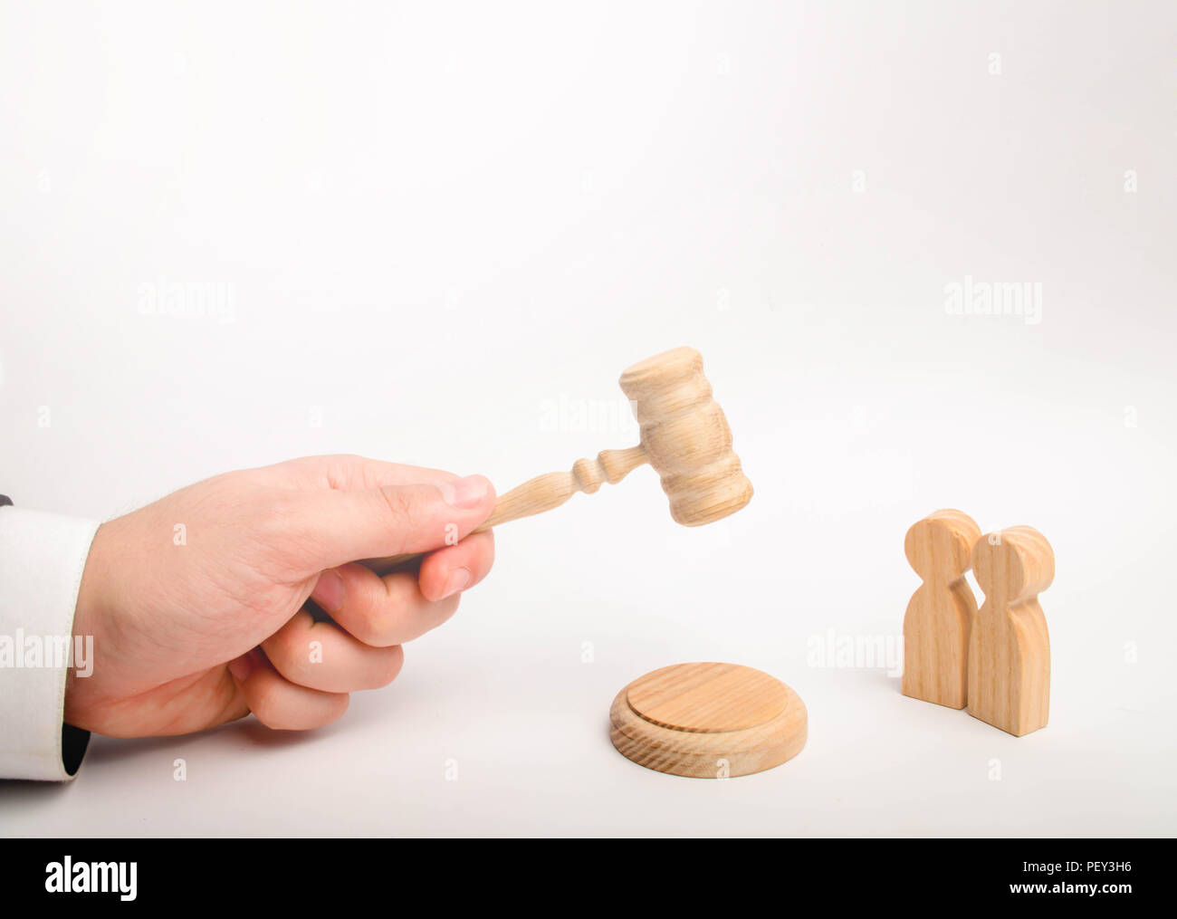 Two men and a hammer of the judge. The trial of cases in court, the resolution of a dispute between two people. Business relations, ascertaining the o Stock Photo