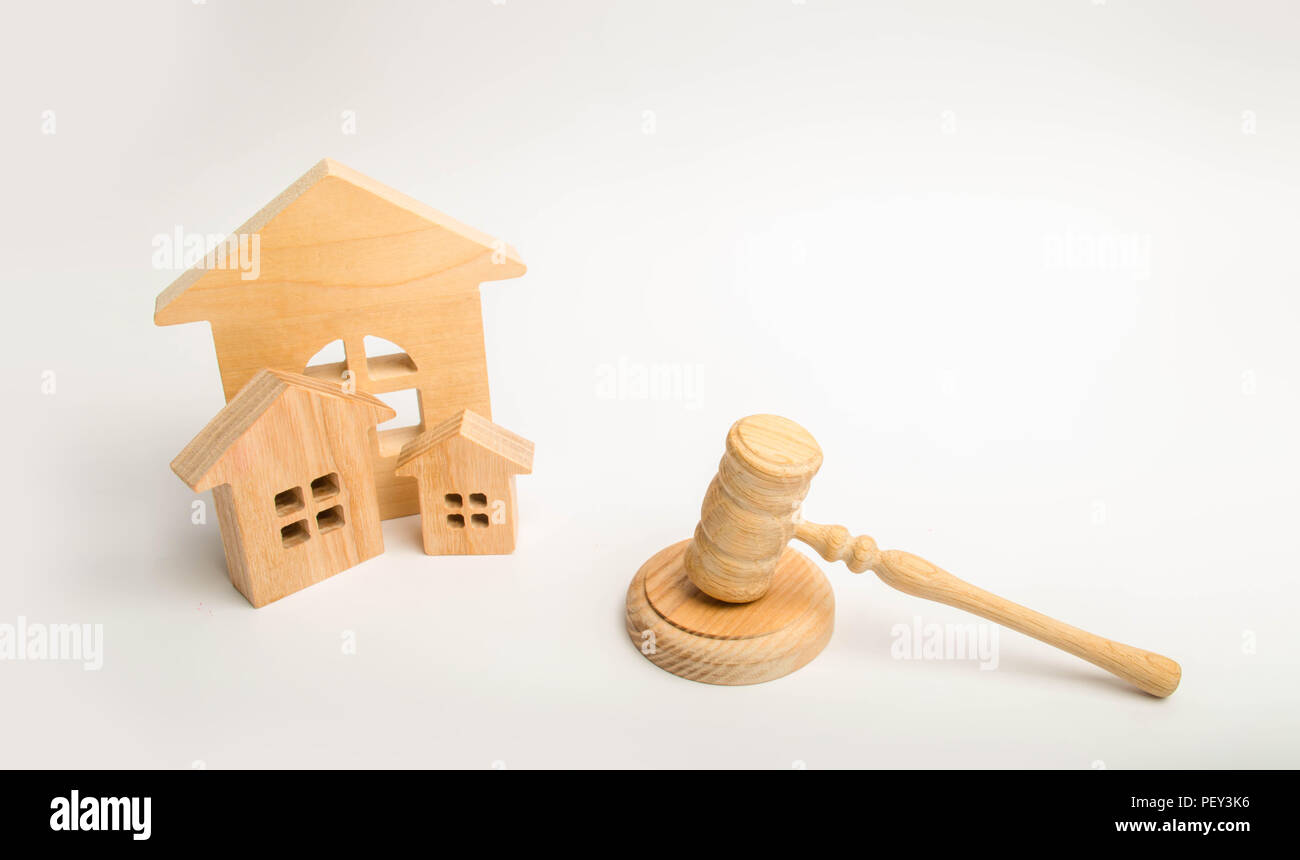 Judge's hammer and wooden houses. Local government, self-government in a city or township. Decentralization, reservation. Administrative District, Reg - Stock Image