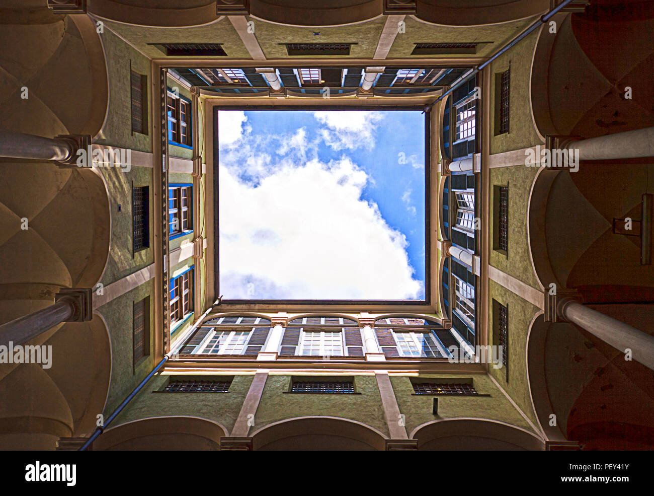 Looking up to the sky from the yard of a building of the University of Genoa, beautiful antique palace of 17th century  surrounded by a porch - Stock Image