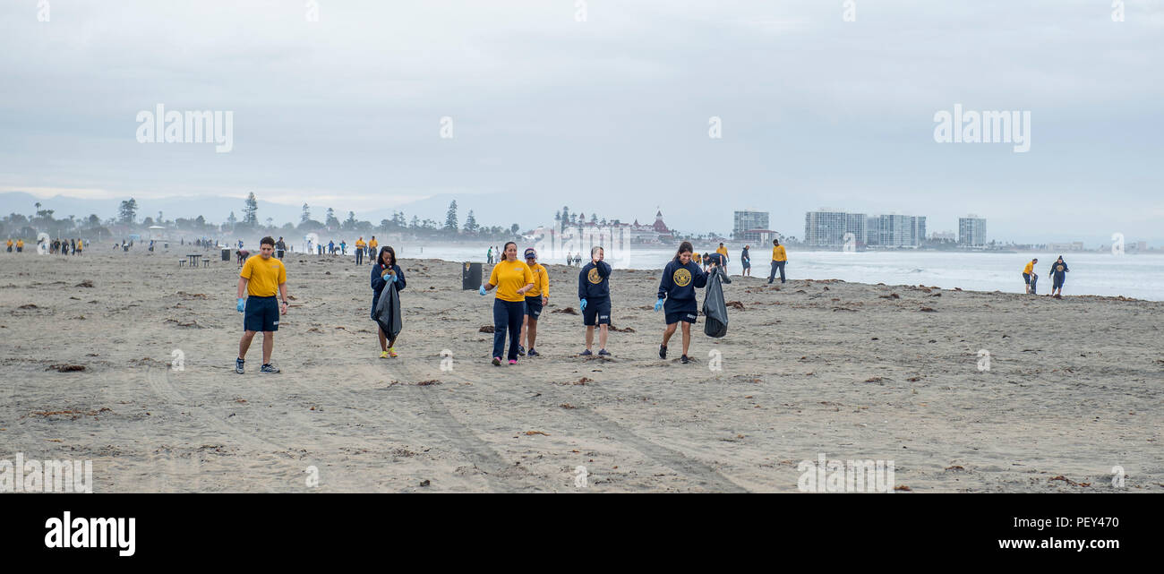 SAN DIEGO (Feb. 18, 2016) – Sailors pick up trash on Breakers Beach aboard Naval Base Coronado (NBC) during a two-day beach clean up. NBC conducts beach cleanups in the San Diego-area each year as part of its environmental stewardship initiative. (U.S. Navy photo by Mass Communication Specialist 3rd Class Gerald Dudley Reynolds/Released) - Stock Image