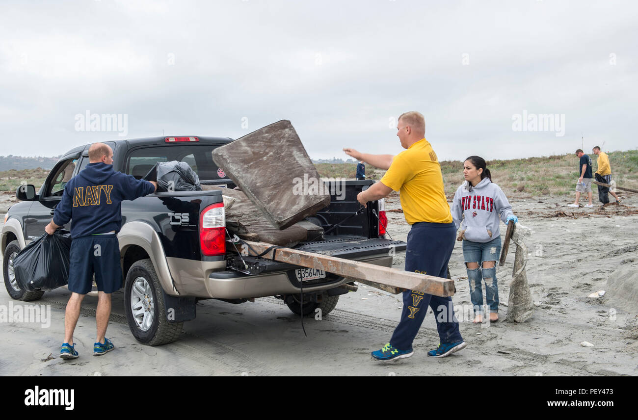 SAN DIEGO (Feb. 18, 2016) – Sailors load trash onto a truck during a beach clean up on Breakers Beach aboard Naval Base Coronado (NBC). NBC conducts beach cleanups in the San Diego-area each year as part of its community service initiative. (U.S. Navy photo by Mass Communication Specialist 3rd Class Gerald Dudley Reynolds/Released) - Stock Image