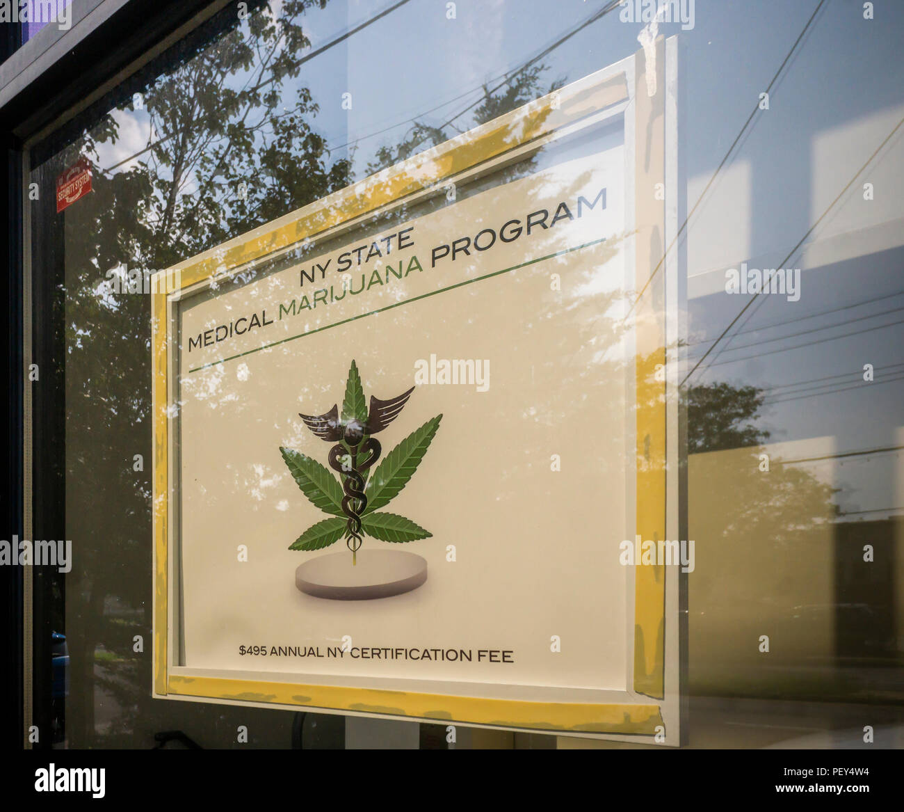 A sign n the window of a practitioner's office in New York informs patients that they participate in the New York State Medical Marijuana Program, seen on Wednesday, August 15, 2018. The New York State Medical Marijuana Program allows patients suffering from specified serious conditions who also have a condition clinically associated with, or a complication of, the serious condition to be certified by a practitioner to receive medical marijuana products to be used for medical use. (© Richard B. Levine) - Stock Image