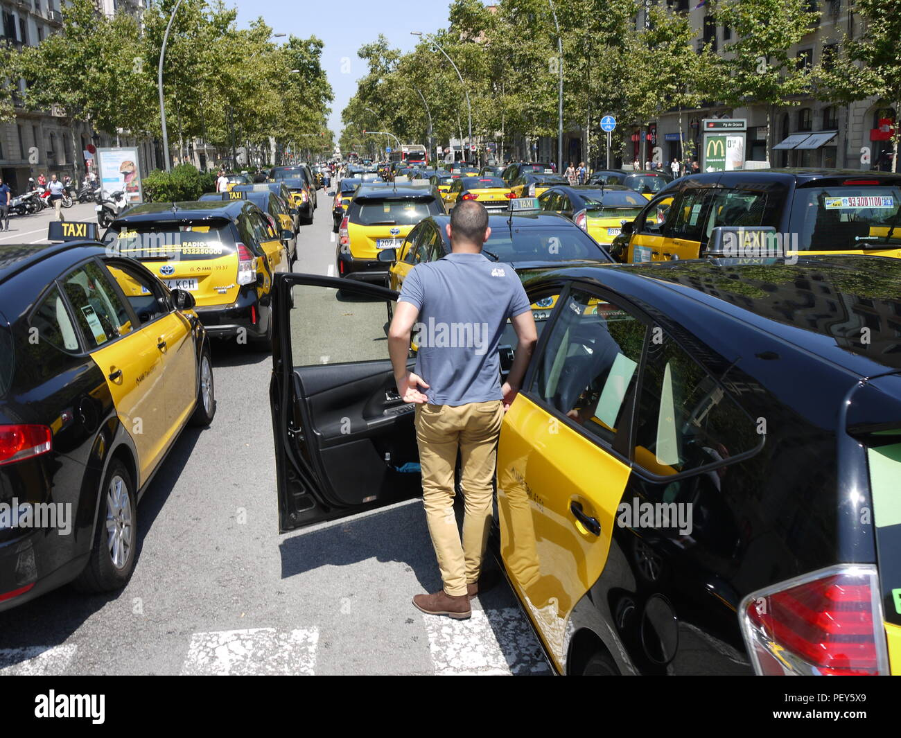 Taxis of Barcelona  gather in a street of city center to protest against new regulation during touristic season Stock Photo