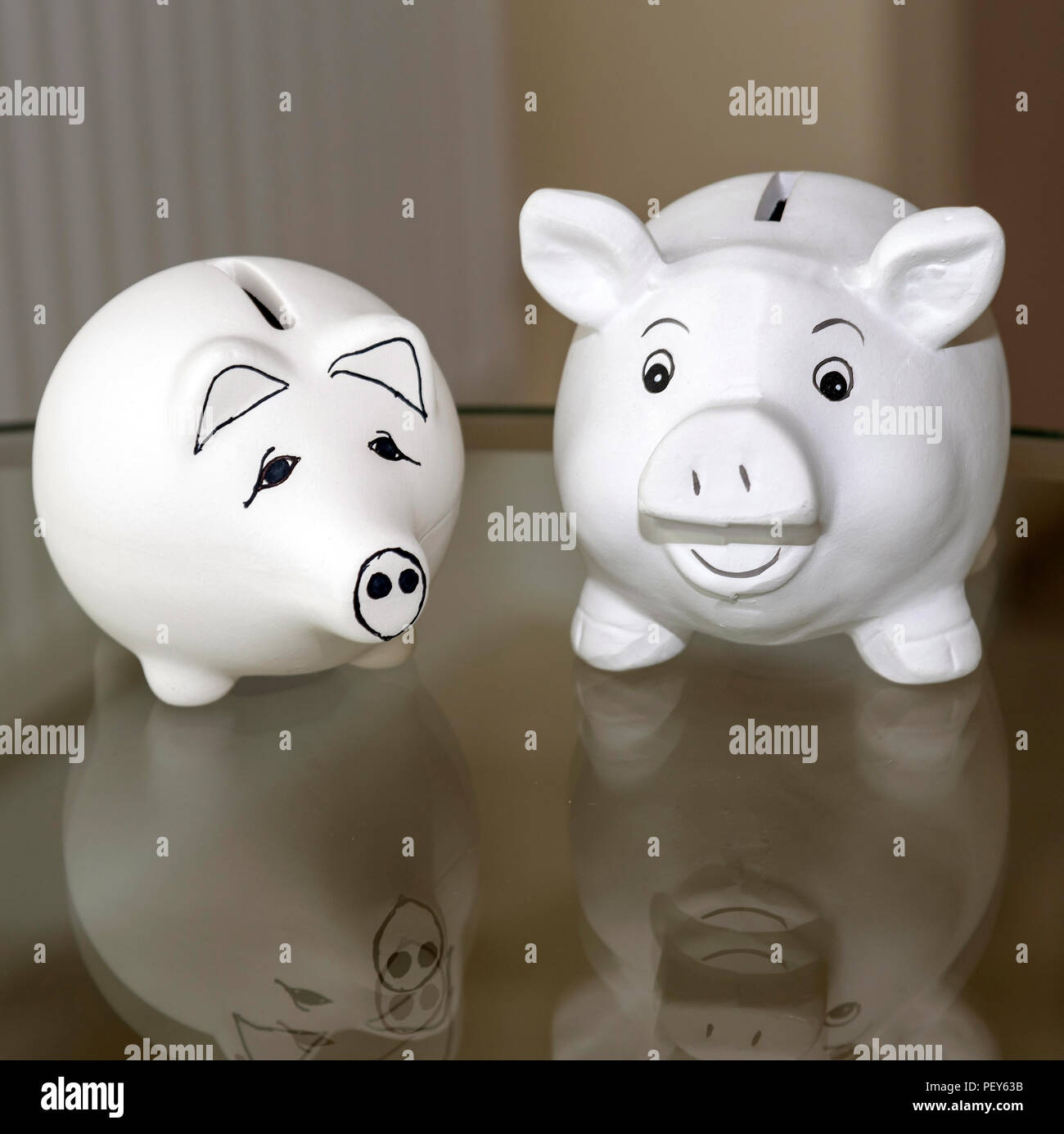 Two Piggy banks used for saving money. Stock Photo