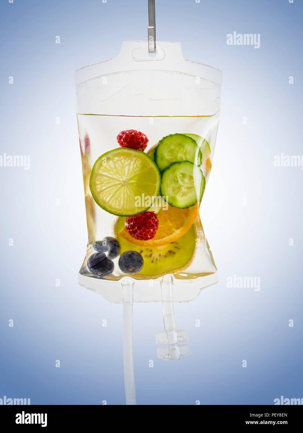 IV bag with fruits, studio shot. - Stock Image