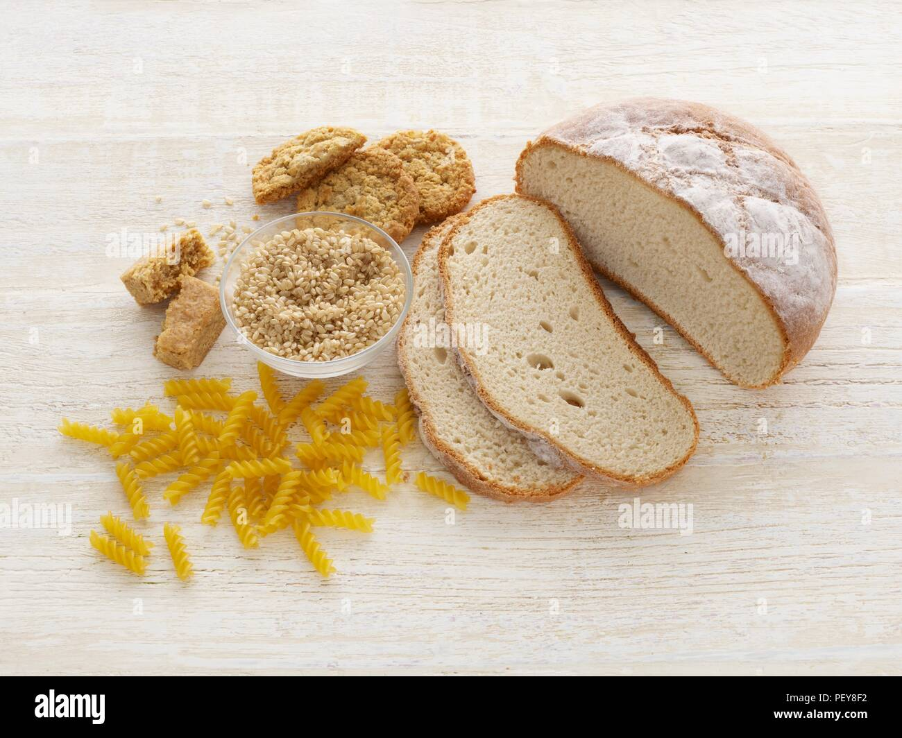 Bread and pasta, studio shot. - Stock Image