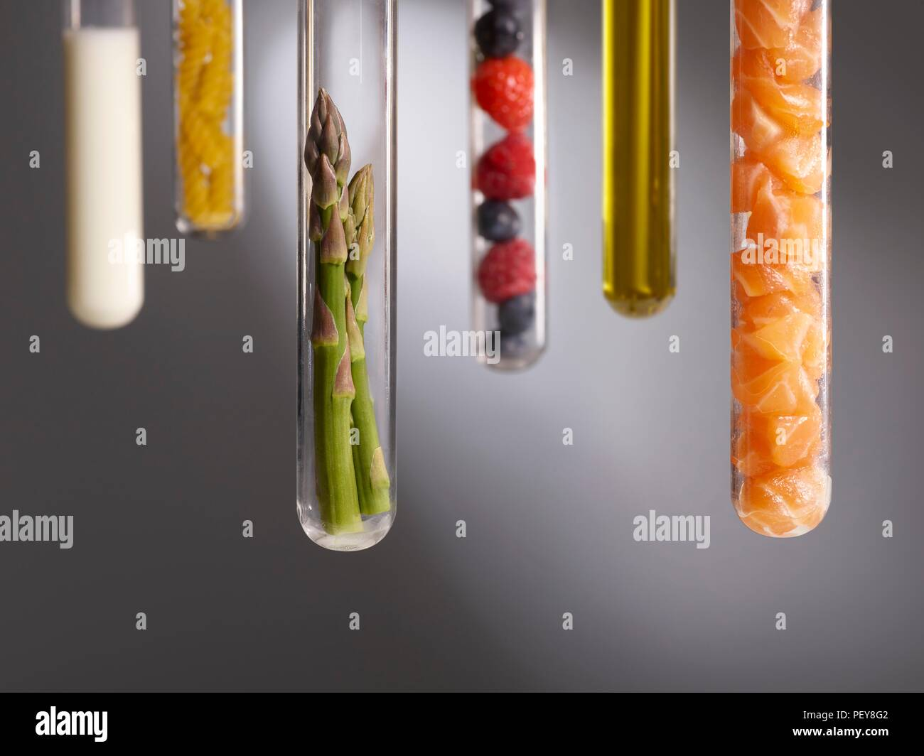 Food groups in test tubes, studio shot. - Stock Image