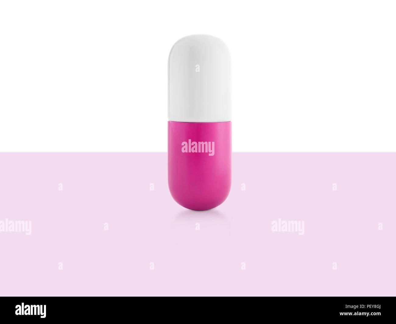 Pink and white capsule, studio shot. - Stock Image