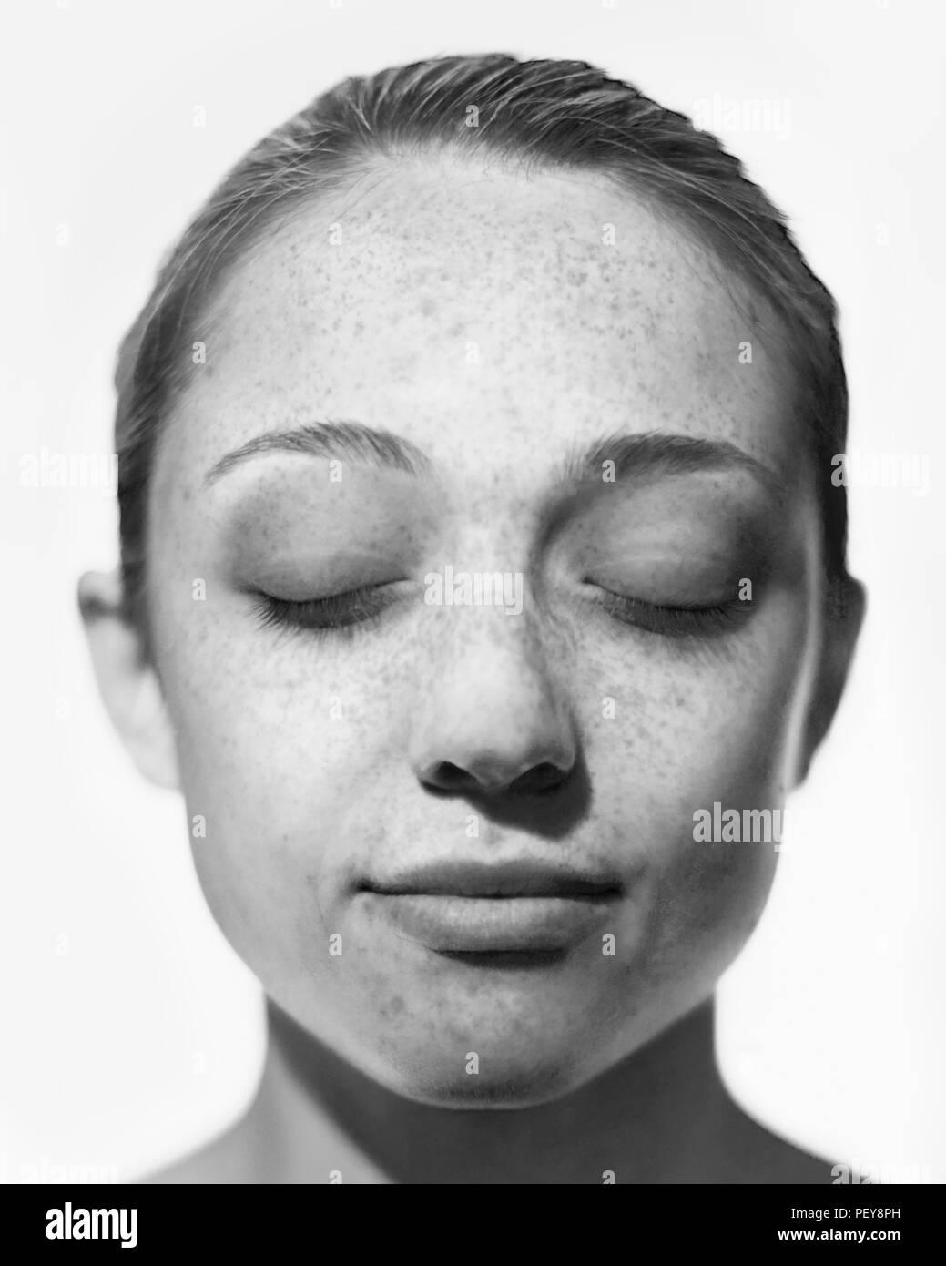 Sun damage on woman's face. - Stock Image