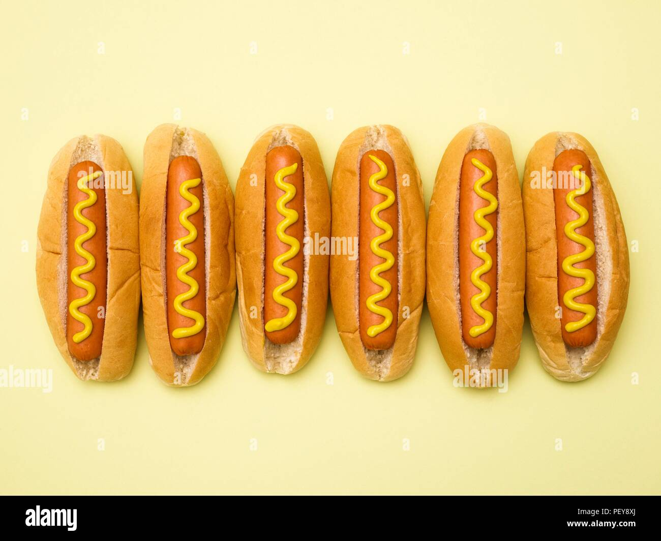 Hot dogs against a plain background. - Stock Image