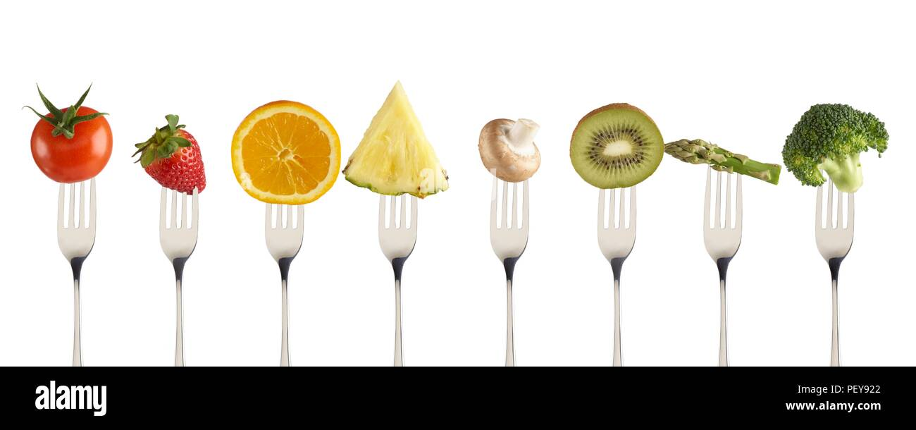 Fresh fruit and vegetables on forks. - Stock Image
