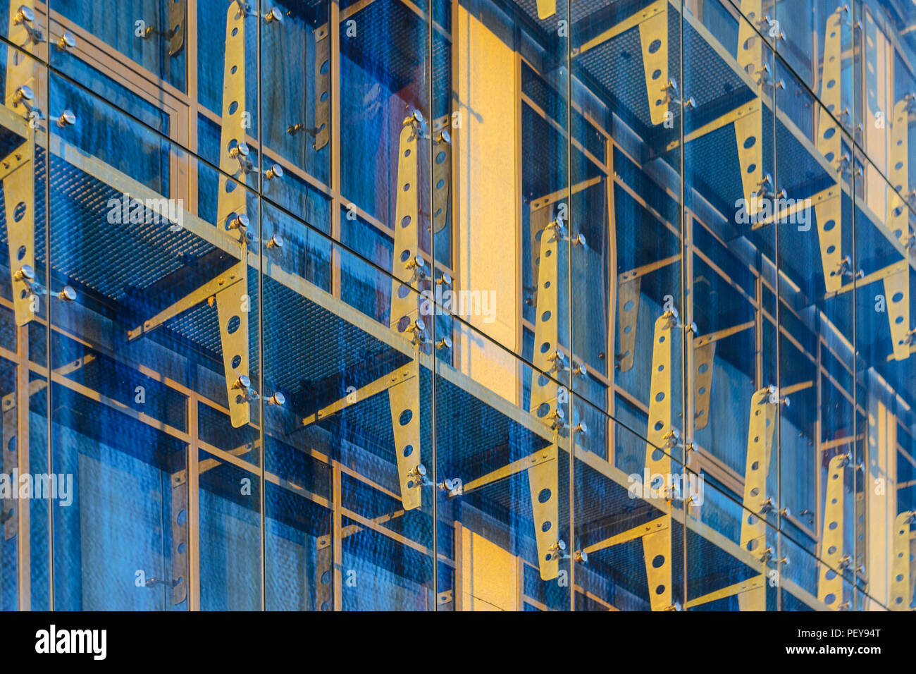 Glass Curtain Facade Wall. Fasteners Elements of Spider Glass System. Facade Detail. Architecture Abstract Background. Stock Photo