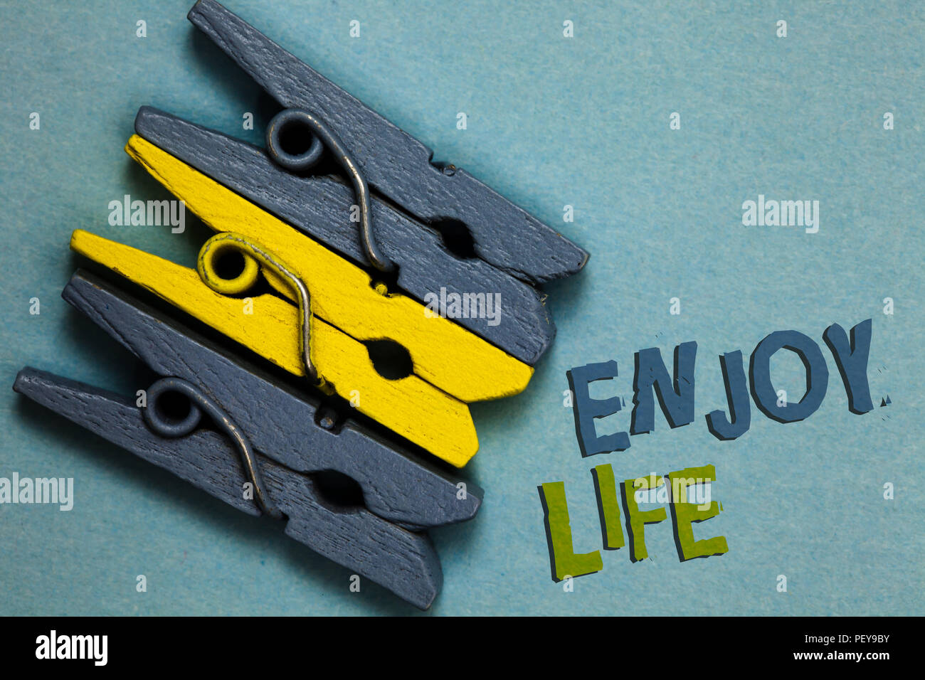 Conceptual hand writing showing Enjoy Life. Business photo text Any thing, place,food or person, that makes you relax and happy Gray yellow vintage cl - Stock Image