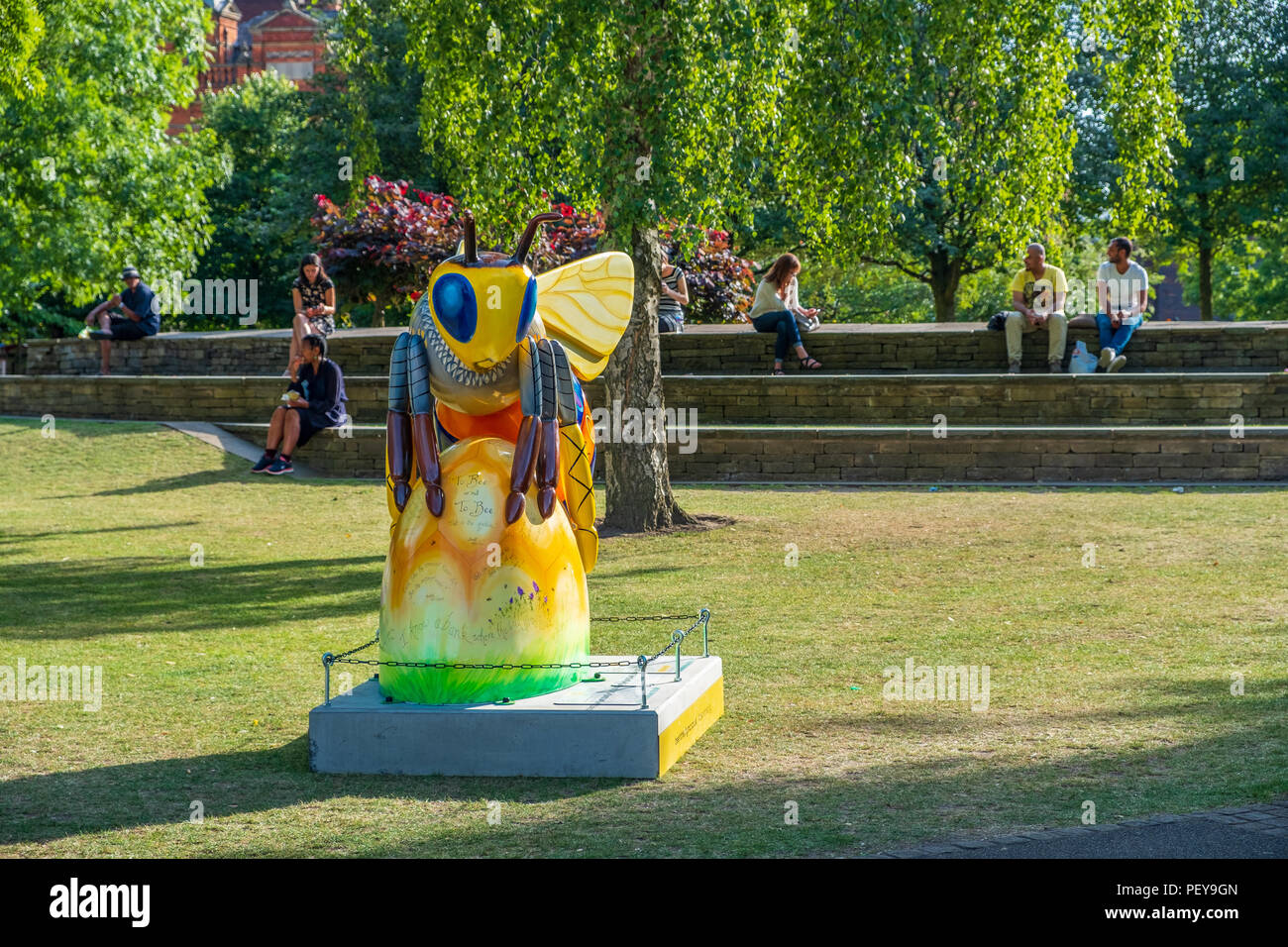 Manchester, United Kingdom - July 25, 2018: A Bee in the City sculpture in All Saints Park. Over 100  Bee Sculptures are publicly being displayed. - Stock Image