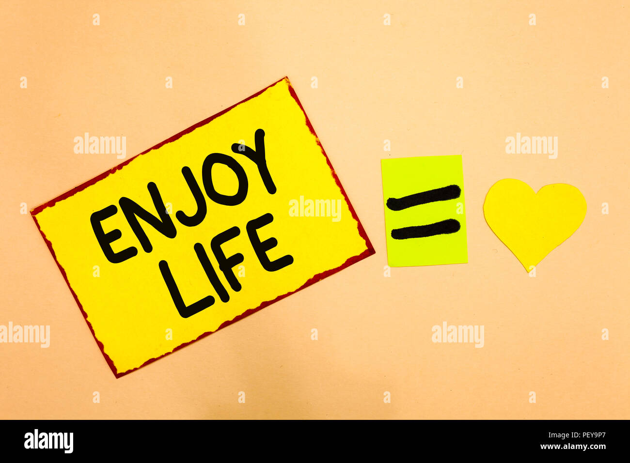 Conceptual hand writing showing Enjoy Life. Business photo text Any thing, place,food or person, that makes you relax and happy Yellow paper reminder  - Stock Image